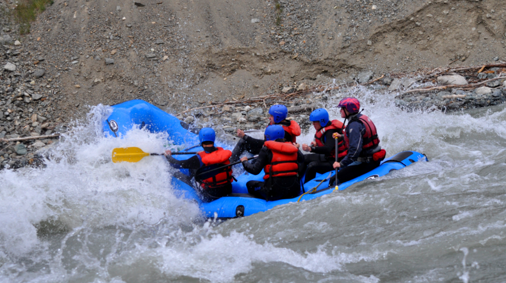 Everyone is outfitted with helmets and wetsuits as we descend through a beautiful canyon
