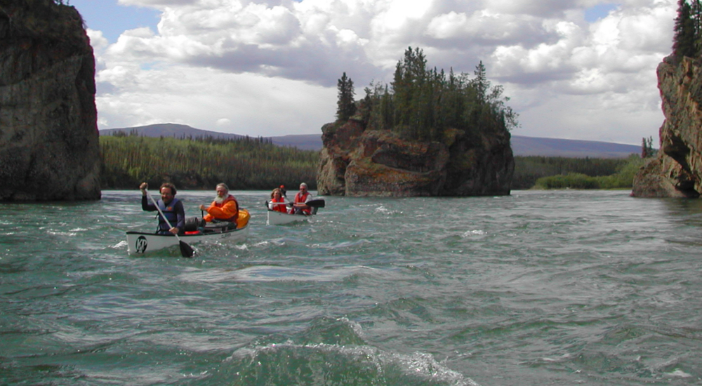 Paddling through five finger rapids on the Yukon River