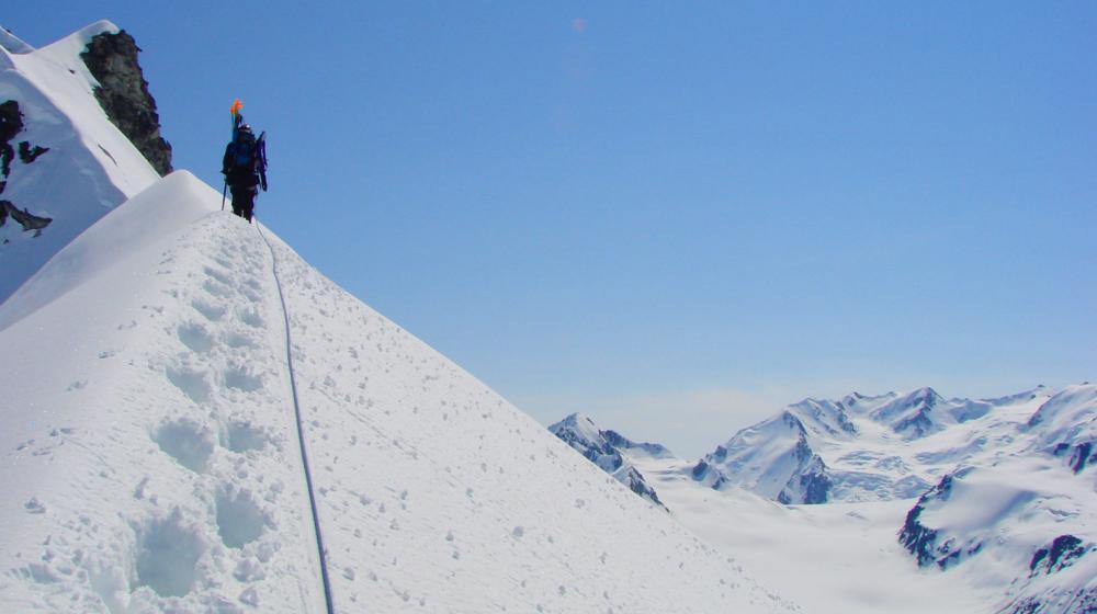 Climb summits in Alaska