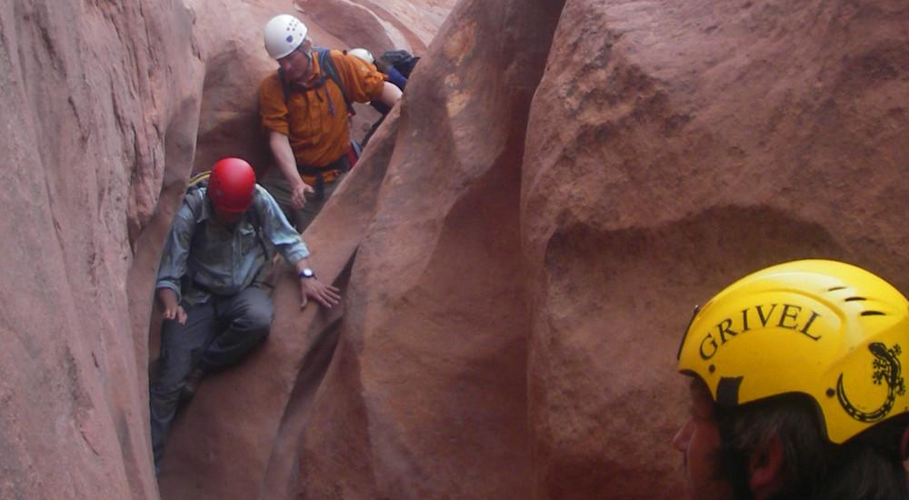 Descending a slot canyon in Escalante-Grand Staircase National Monument