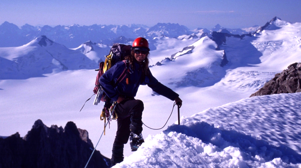 Company founder Sean Gaffney crestin a summit ridge on the upper Davidson Glacier