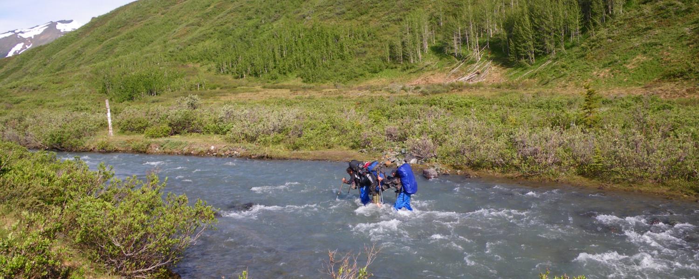 Group crossing a creek on the Cottonwood Trail, Kluane National Park, Yukon Territory