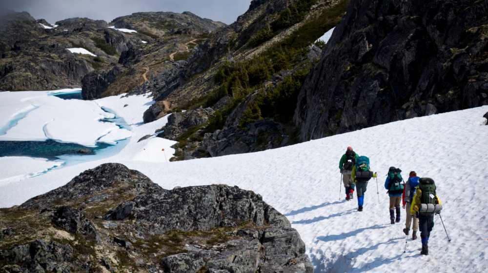 Early season hikes on the Chilkoot often have snow fields near the pass